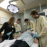 Emergency Department Crew at UW Hospital analyzes patient