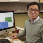 Bu Wang at his computer