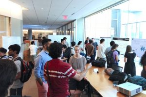 People gather for a poster session